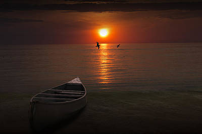 Beached Canoe During Sunset Poster