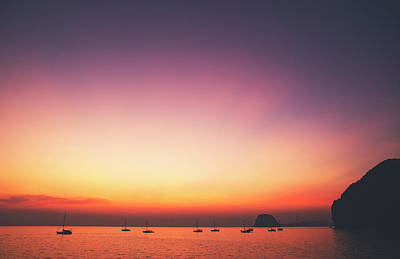Beautiful And Serene Sunset View Over A Lagoon Bay With Couple Of Yachts And Islands In Distance Poster