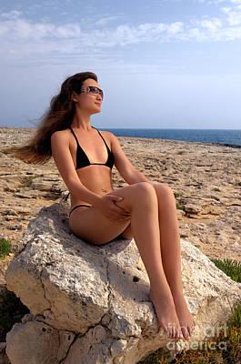 Beautiful Sexy Woman In Bikini Relaxing On A Rocky Seashore Poster