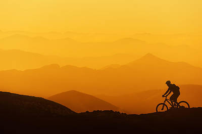Biker Riding On Mountain Silhouettes Background Poster