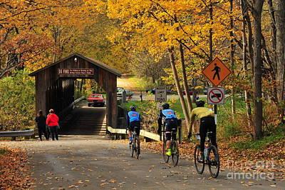 Biking Across The Fallasburg Covered Bridge Poster by Terri Gostola