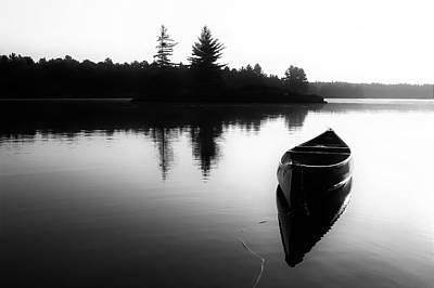 Black And White Canoe In Still Water Poster