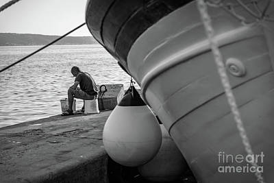 Black And White - Fisherman Cleaning Fish On Docks Of Kastel Gomilica, Split Croatia Poster