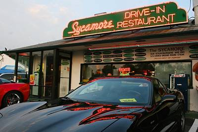 Black Sports Car In Front Of The Sycamore Poster