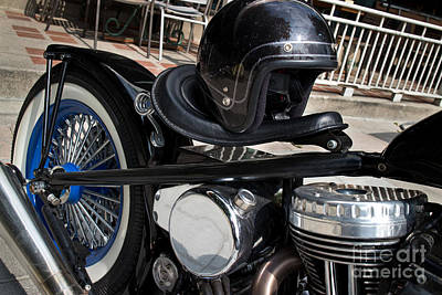 Black Vintage Style Motorcycle With Chrome And Black Helmet Poster by Jason Rosette