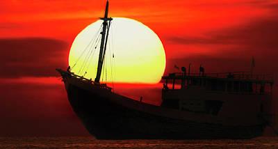 Poster featuring the photograph Boatman Enjoying Sunset by Pradeep Raja Prints