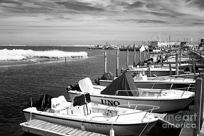 Boats Lined Up Infrared Poster by John Rizzuto