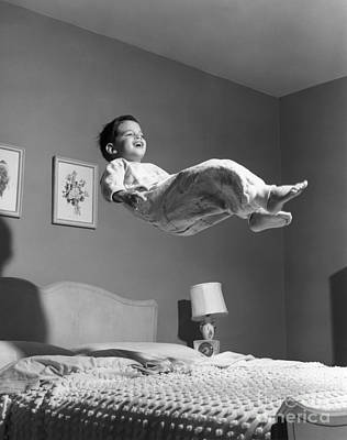 Boy Jumping On Bed, C.1950s Poster by O. Johnson/ClassicStock