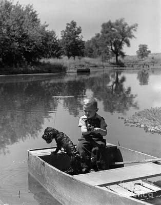 Boy With Dog In Fishing Boat Poster