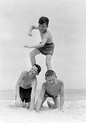 Boys In Pyramid Formation At Beach Poster by H. Armstrong Roberts/ClassicStock