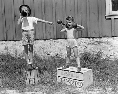 Boys Playing Carnival Strongman Poster by H. Armstrong Roberts/ClassicStock