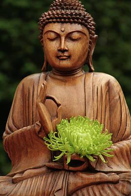 Buddha Statue Holding Flower Poster