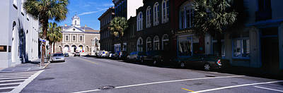 Buildings On Both Sides Of A Road Poster by Panoramic Images