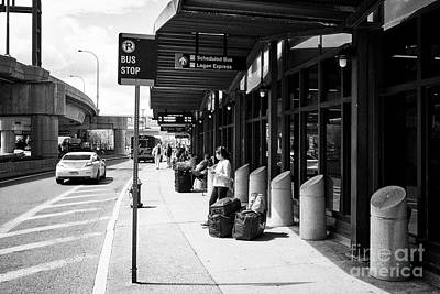 bus stop outside Boston Logan international airport exterior USA Poster