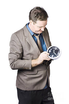 Businessman Adjusting Time Poster by Jorgo Photography - Wall Art Gallery