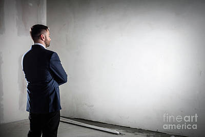 Businessman Standing In An Open Empty Space Indoors And Looking At The Wall. Poster by Michal Bednarek