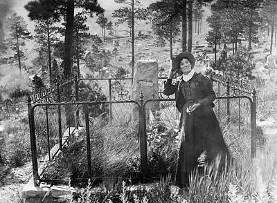 Poster featuring the photograph Calamity Jane At Wild Bill Hickok's Grave 1903 by Daniel Hagerman