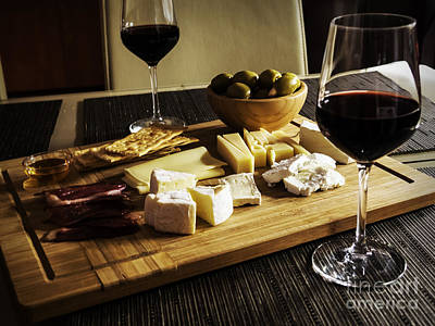 Camembert, Gouda And Brie Cheese Platter With Wine Glasses Poster by Radu Bercan
