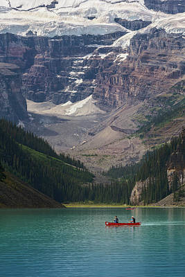 Poster featuring the photograph Canoe On Lake Louise by Debby Herold
