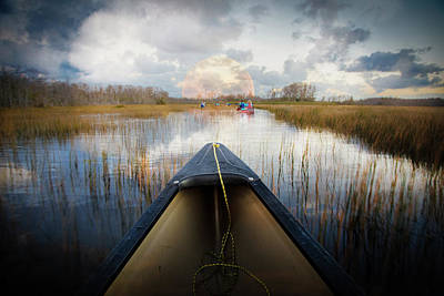 Canoeing Into Moonlight Poster by Debra and Dave Vanderlaan