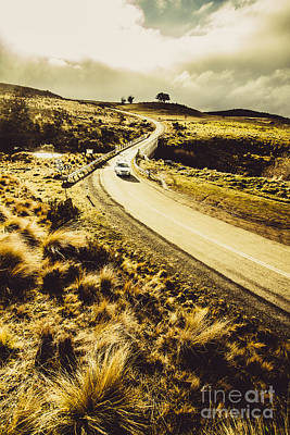Car Touring The Central Highlands In Tasmania Poster by Jorgo Photography - Wall Art Gallery