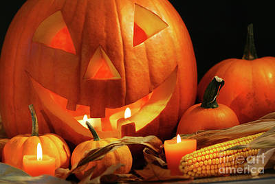 Carved Pumpkin With Candles Poster by Sandra Cunningham