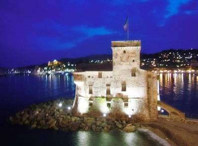 Castle Of Rapallo At Night Poster