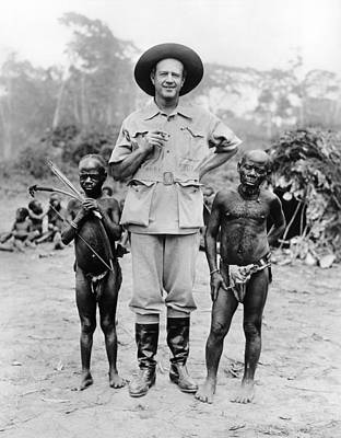 Caucasian Man With Two African Pigmy Poster by Everett
