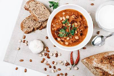 Chili Beans Stew, Bread, Red Chili Pepper And Garlic Ready To Be Served Poster by Radu Bercan
