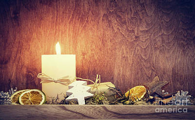 Chistmas Decoration With Candle Glowing On Wooden Wall Background Poster by Michal Bednarek
