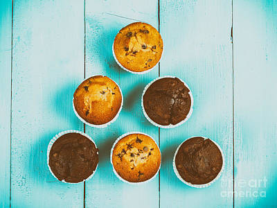 Chocolate Chip Muffins On Blue Table Poster
