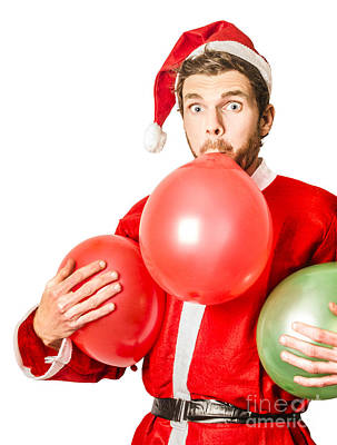 Christmas Party Planner Blowing Up Balloons Poster by Jorgo Photography - Wall Art Gallery