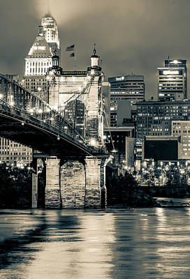 City Of Cincinnati And Roebling Bridge On The River - Black And White Poster by Gregory Ballos