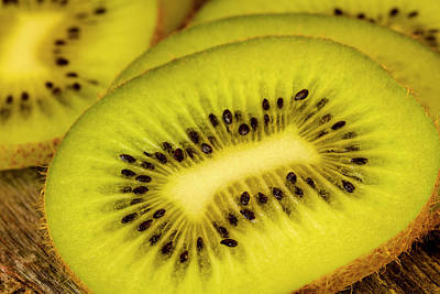 Close Up Of Kiwi Slices Poster by Teri Virbickis