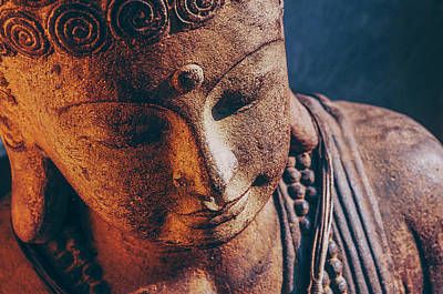 Closeup Of A Stone Carved Buddha Head Poster