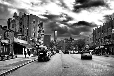 Clouds Over 7th Avenue Poster by John Rizzuto