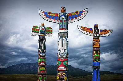 Colorful Totem Poles In The Northwest Poster by Randall Nyhof
