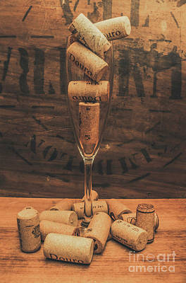 Corks Balanced On An Empty Champagne Flute Poster by Jorgo Photography - Wall Art Gallery