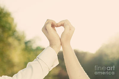 Couple In Love Making A Heart Shape With Their Hands Outdoors Poster