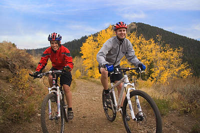 Couple On Mountain Bikes Poster by Utah Images