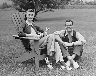 Couple Sitting Outdoors Poster