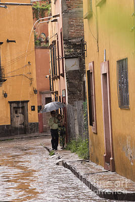 Couple Walking In The Rain Through Old San Miguel Mexico Poster by Juli Scalzi