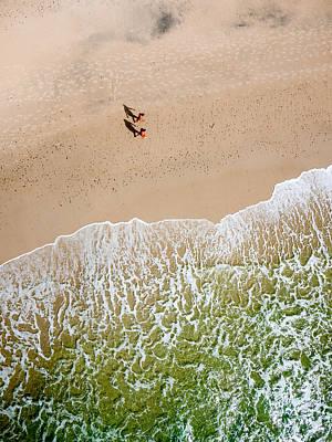Couple Walking On Tallow Beach Poster