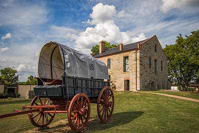 Covered Wagon And Stone Building Poster by James Barber