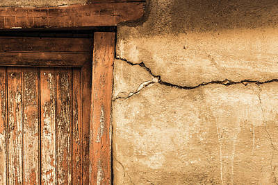 Cracked Lime Stone Wall And Detail Of An Old Wooden Door Poster by Semmick Photo