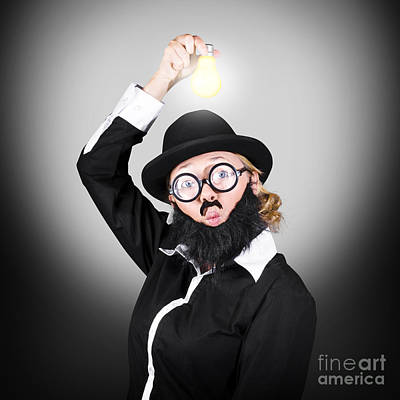 Creative Business Man Holding Light Bulb Poster by Jorgo Photography - Wall Art Gallery