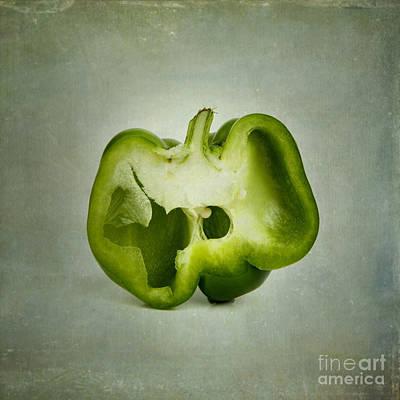 Cut Green Bell Pepper Poster by Bernard Jaubert