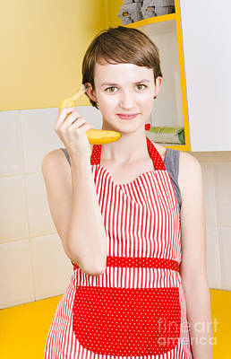 Cute Girl Talking On Fruit Phone In Kitchen Poster