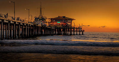 Daylight Turns Golden On The Pier Poster