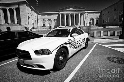 dc police car in front of District of Columbia City Hall now the court of appeals judiciary square W Poster by Joe Fox
